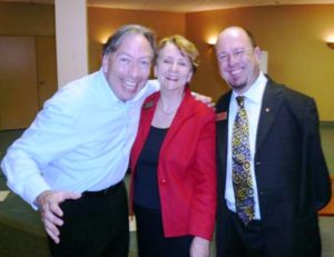 Picture of Patricia with humorist, Michael Kerr and motivational speaker, Alvin Law