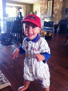 Baby Elliott toddling with his ball cap