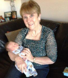 Patricia holding grandson