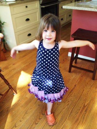Little girl dancing with joy1