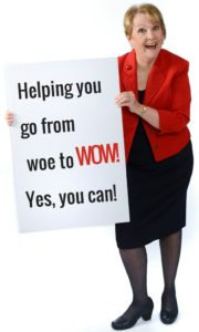 "Patricia with sign that reads ""Helping you go from woe to WOW!"