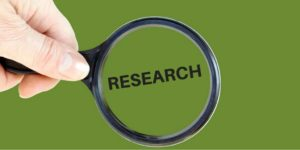 magnifying glass with research