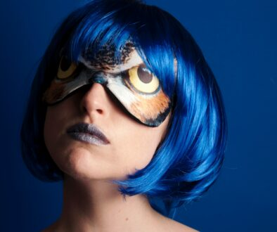 woman with blue hair who looks mentally ill